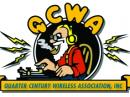 The QCWA logo: a white bearded man working a key.