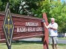 The author with his Yaesu hat in front of the ARRL HQ sign.