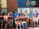 Students at the Advanced Teachers Institute class at ARRL Headquarters display their marine buoys, used to teach data collection. [Debra Johnson, K1DMJ, photo]