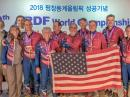 ARDF Team USA 2018 members display their medals. (Front, from left to right) Alla Mezhevaya; Vadim Afonkin, KB1RLI; Ruth Bromer, WB4QZG; Joseph Huberman, K5JGH; Ken Harker, WM5R, and Lori Huberman. (Rear, from left to right) Bob Cooley, KF6VSE; Eduard Nasybulin; Nicolai Mejevoi; Bill Wright, WB6CMD, and Joseph Burkhead. [Mindy Johnson photo]