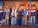 Twelve of the members of USA's delegation to the 16th ARDF World Championships. Left to right are Ruth Bromer, WB4QZG; Lori Huberman; Joseph Huberman, K5JGH; Nicolai Mejevoi; William Smathers, KG6HXX; Scott Moore, KF6IKO; Alla Mezhevaya; Jay Hennigan, WB6RDV; George Neal, KF6YKN; Vadim Afonkin, KB1RLK; Harley Leach, KI7XF, and Karla Leach, KC7BLA. Not shown are Bob Cooley, KF6VSE, and Marvin Johnston, KE6HTS, who was a member of the international jury. [Jay Hennigan, WB6RDV, photo]