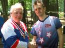 Dick Arnett, WB4SUV, of Kentucky (left), receives his medal for first place finish in the M60 category at the 2009 USA Championships near Boston. Dick is a co-chair of the organizing committee for the upcoming 2010 USA championships. Presenting the medal is Vadim Afonkin, KB1RLI, who organized the 2009 events. [Joe Moell, K0OV, Photo]
