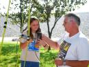 All ages are welcome at the regular ARDF practice and antenna-assembling sessions in Southern California. David White, WD6DRI, is shown here helping his daughter Kelsey learn how to use the measuring-tape Yagi that she just finished building. [Joe Moell, K0OV, Photo]