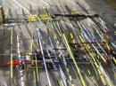 These 2 meter ARDF sets are awaiting competitors at the equipment impound area of the 2008 World Championships. Almost all of them feature Yagi directional antennas made from springy steel tape. [Ken Harker, WM5R, Photo]