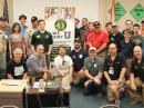 A College Amateur Radio Initiative contingent (and friends) attended HamCation. ARRL CEO Tom Gallagher, NY2RF, is in the front row, third from the left, kneeling. [Bob Inderbitzen, NQ1R, photo]