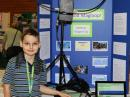 Dragan Tuip, KG7OQT, with his magnetic loop antenna at the Washington State Science and Engineering Fair. [Mike Bay/WSSEF photo]
