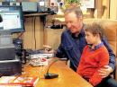 "Tim Allen as Mike Baxter, KA0XTT, in a 2013 episode in his ham shack with his grandson ""Boyd,"" played by Flynn Morrison."