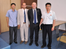 Unidentified North Korean telecommunications ministry officials flank Manuel German, EA7AJR (second from left), and Tony Gonzales, EA5RM, during a visit to Pyongyang, North Korea.