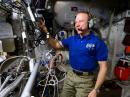 Tim Kopra, KE5UDN, speaks to students from NA1SS onboard the International Space Station. [NASA photo]