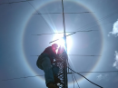 In preparation for the KP4FD IARU World Amateur Radio Day special event operation, Carlos Colon, WP4U, was changing the rotator for a 40 meter antenna on April 11, when a solar halo formed. [Luis Gonzalez, NP4RA, photo]