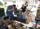 Will Stewart, getting coached on how to make QSOs. [Sterling Coffey, N0SSC, Photo]