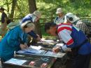 When you are given your orienteering map just before the competition starts, you may want to mount it on a flat surface for ease in marking bearings. Five competitors are getting ready for the 80 meter competition at the 2011 USA ARDF Championships: (left to right) Karla Leach, KC7BLA; Dale Hunt, WB6BYU; Matthew Robbins, AA9YH; Bill Smathers, KG6HXX, and Bob Frey, WA6EZV. [Joe Moell, K0OV, Photo]