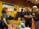 ARRL Education Services Manager Debra Johnson, K1DMJ, and ARRL Education Project Coordinator Mark Spencer, WA8SME, tell a Hamvention visitor all about the ARRL Teachers Institute. [S. Khrystyne Keane, K1SFA, Photo]