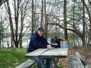"Tom, WB8LCD, manning the ""picnic table portable."" Note the Buddipole antenna in the back."